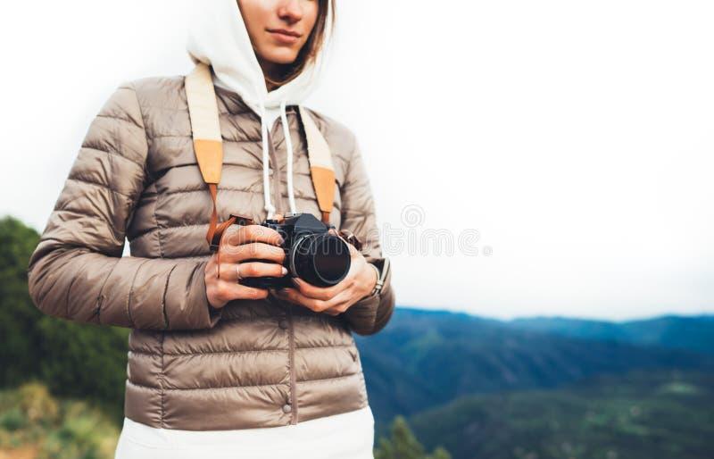 Photographer traveler on green mountain, tourist holding in hands digital photo camera closeup, hiker taking click photography. Girl enjoy nature panoramic stock photography