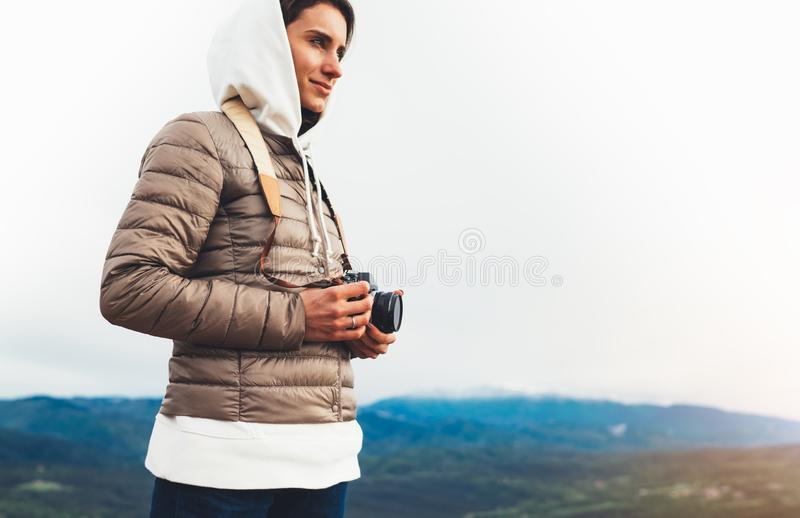 Photographer traveler on green top on mountain, tourist looking enjoy nature panoramic landscape in trip, girl holding in hands stock images