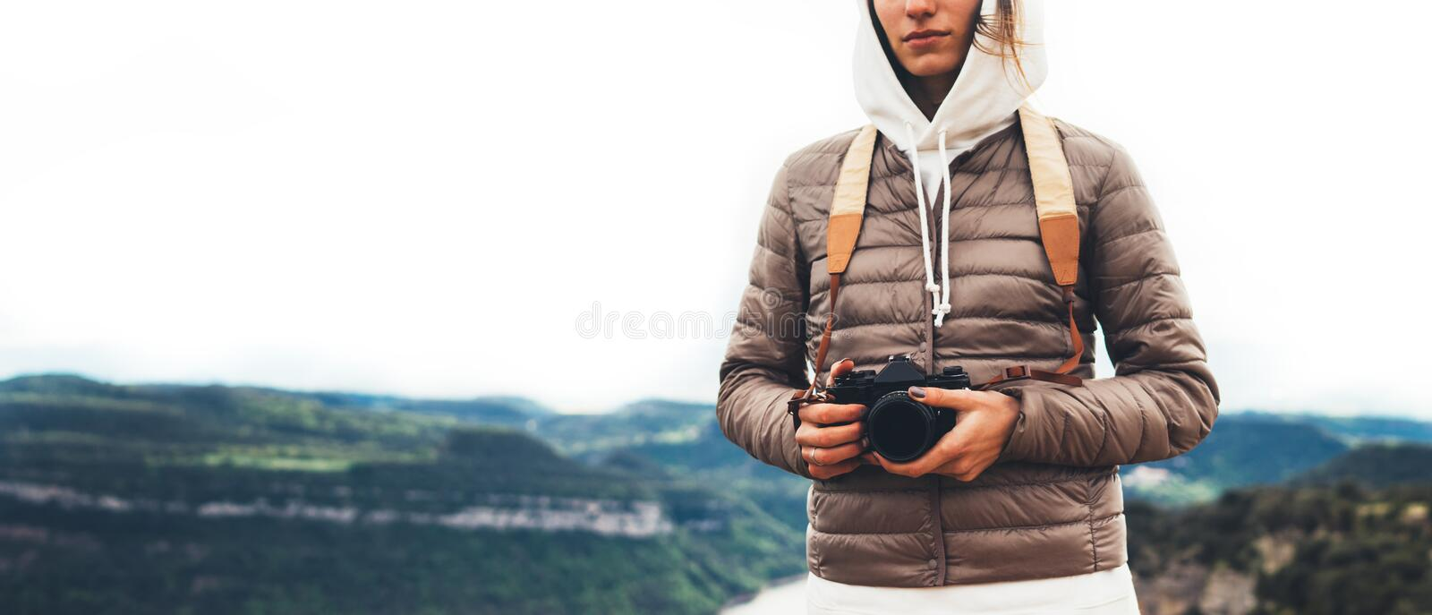 Photographer traveler on green top on mountain, tourist looking enjoy nature panoramic landscape in trip, girl holding in hands royalty free stock images
