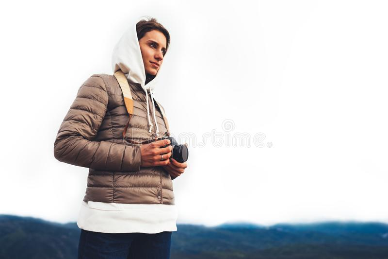 Photographer traveler on green top on mountain, tourist looking enjoy nature panoramic landscape in trip, girl holding in hands stock photos