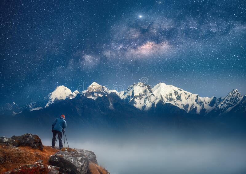 Photographer traveler take a picture of galaxy in mountains the Himalayas. Nepal royalty free stock images