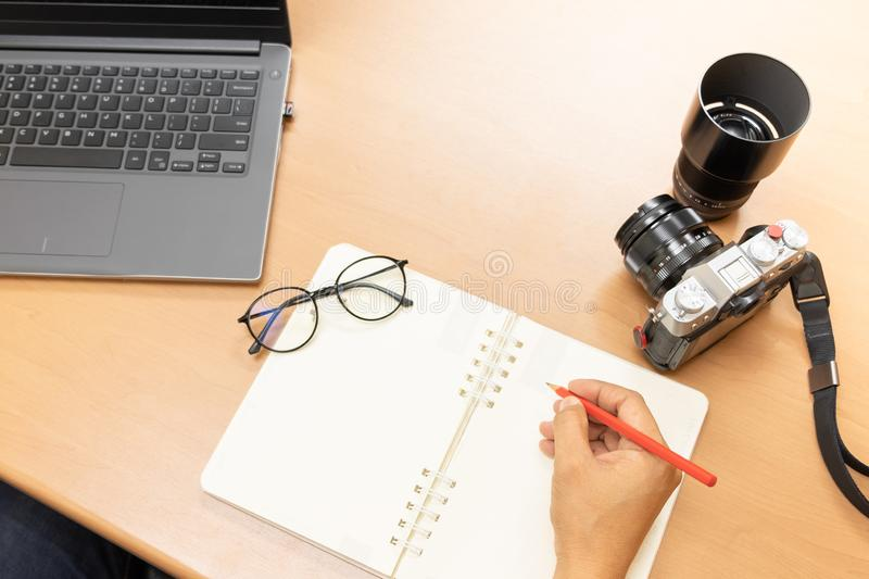 Photographer upload pictures online, Preparation of equipment stock photo