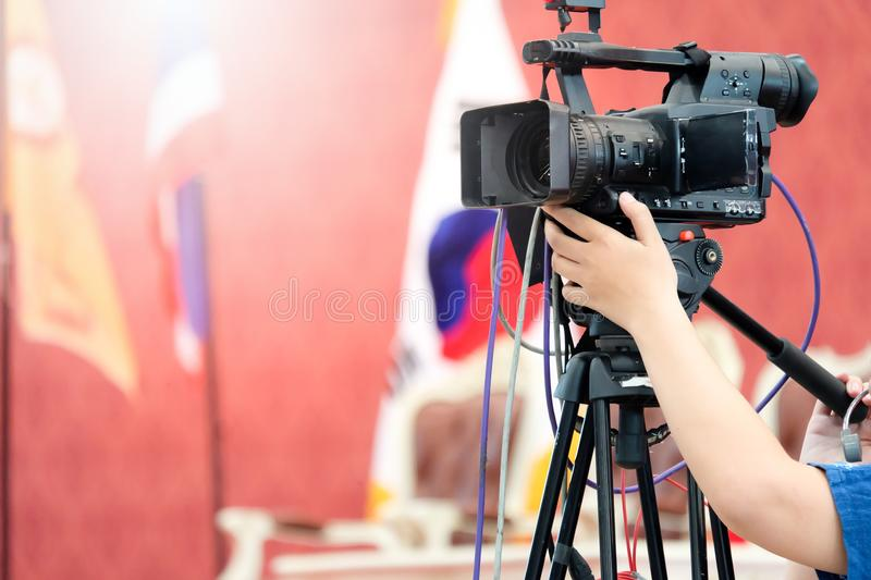 Photographer video recording activity. Within the event stock image