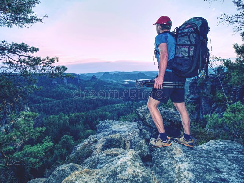 Photographer or videographer traveler with backpack and tripod royalty free stock photography