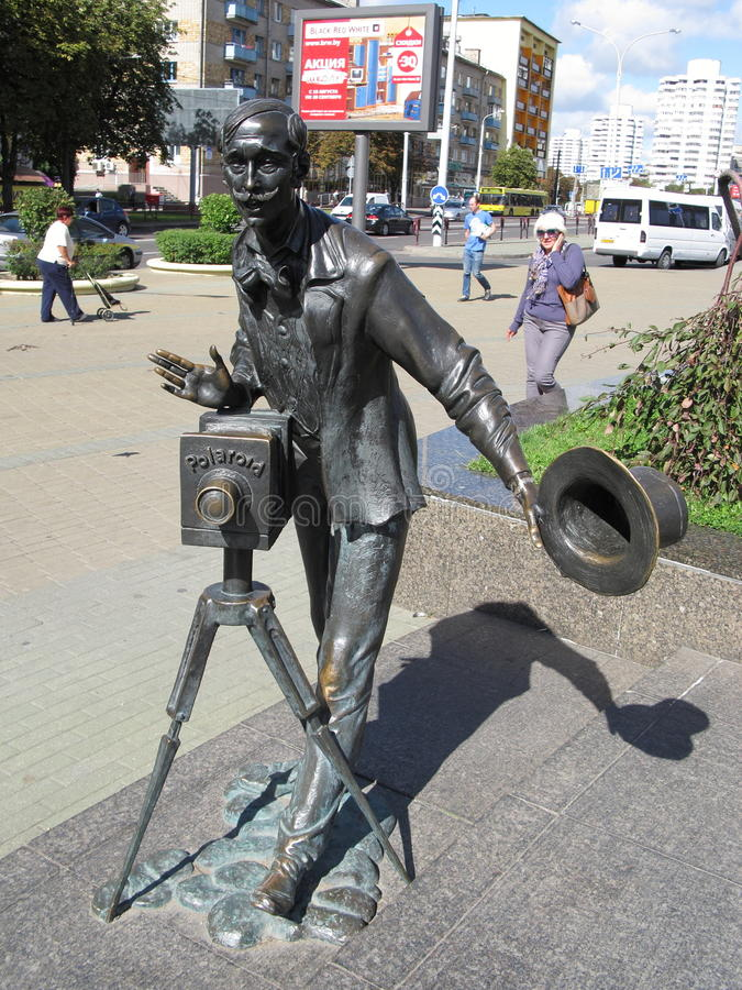 The photographer sculpture by Vladimir Ivanovich Zhbanov at The Komarovsky marketplace in Minks Belarus stock images