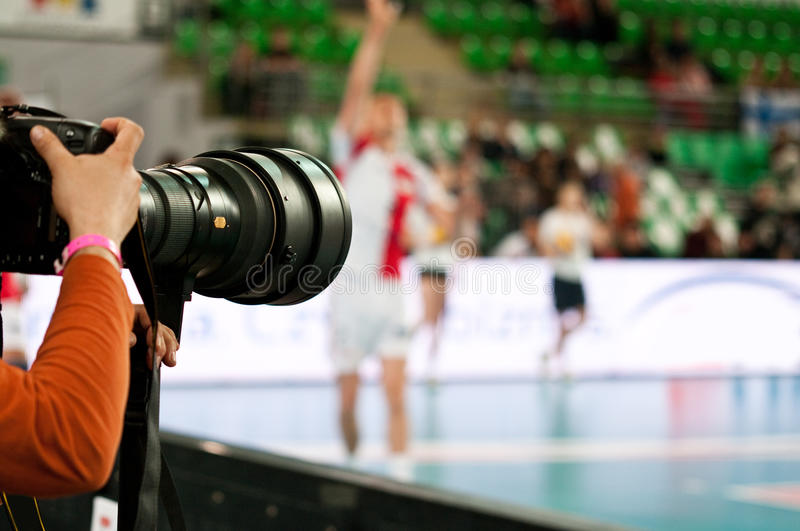 Photographer at volleyball match stock photos