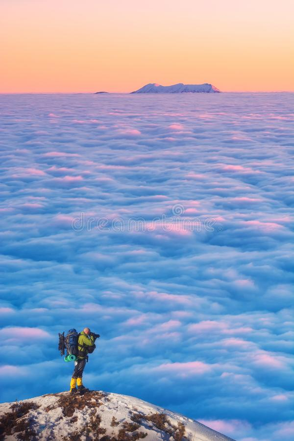 Photographer who take a shot of mountain peak stock images