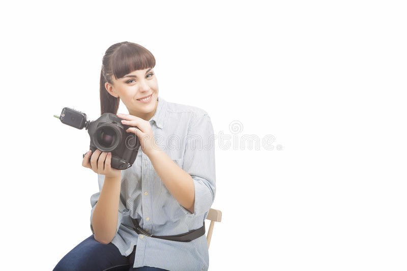 Photographer Woman Holding DSLR Camera Prior to Taking Photographs royalty free stock photos