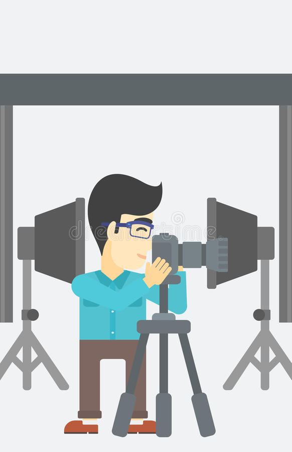 Photographer working with camera on tripod. An asian young photographer working with camera on a tripod in photo studio. Man taking photo with professional royalty free illustration