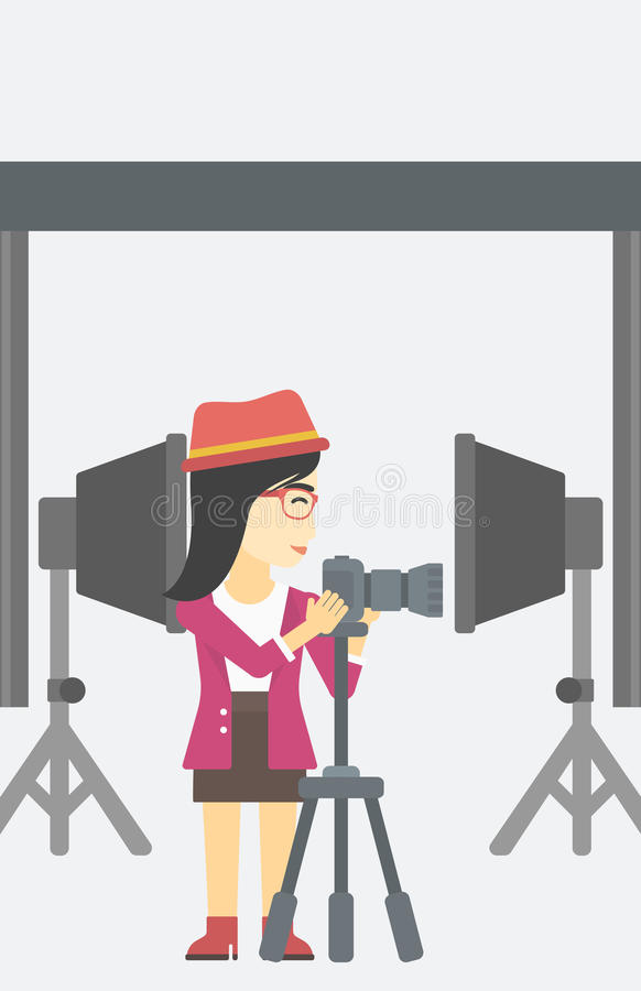 Photographer working with camera on tripod. An asian young photographer working with camera on a tripod in photo studio. Woman taking photo with professional stock illustration