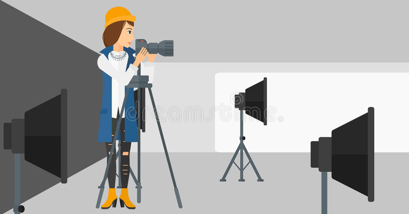 Photographer working with camera on a tripod. A photographer working with camera on the background of photo studio with lighting equipment vector flat design royalty free illustration