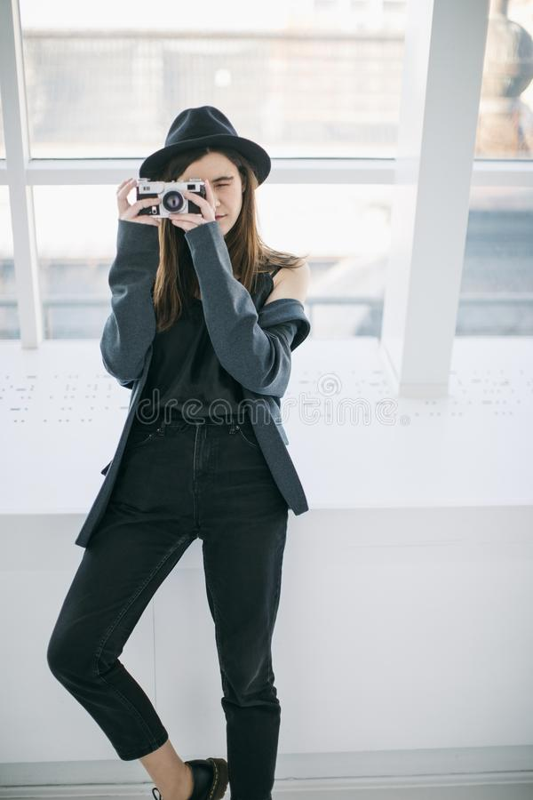 Photographer in working process. Creative hipster teen girl. Stylish casual style stock photos
