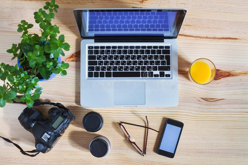 Photographer workplace, gear, top view of desk with laptop royalty free stock photography