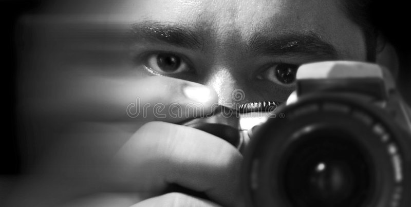 The photographer he photographer. Black and white image of the photographer
