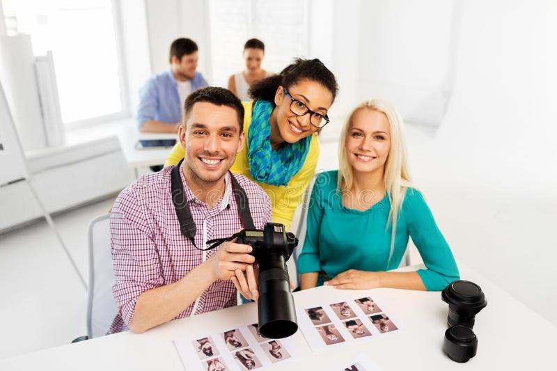 Photographers with camera at photo studio royalty free stock image