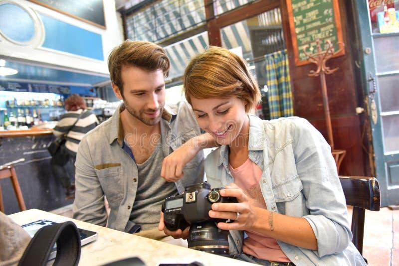 Photographers in coffee shop taking a break stock photo