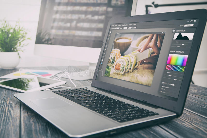Photographers computer with photo edit programs. stock images