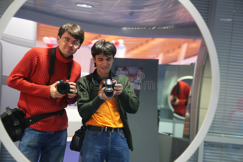 Download Photographers In Curved Mirror Stock Image - Image: 7550417