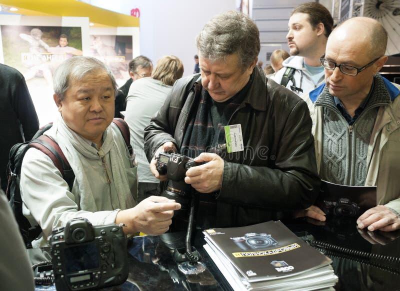 Photographers examine new Nikon products royalty free stock photo