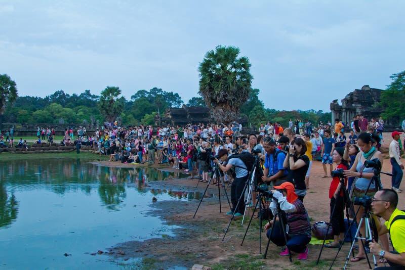 Photographers gather near Angkor Wat pond sunrise