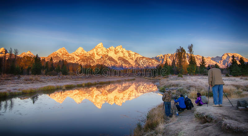 Photographers at Grand Teton National Park. Photographers at Schwabacher`s Landing in Grand Teton National Park, Wyoming royalty free stock images