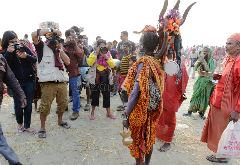 Photographers. A group of photographers taking picture of a Hindu sadhu at the fair ground. Around 160 kms south of Kolkata on January 14, 2015. Sadhus and Hindu stock images