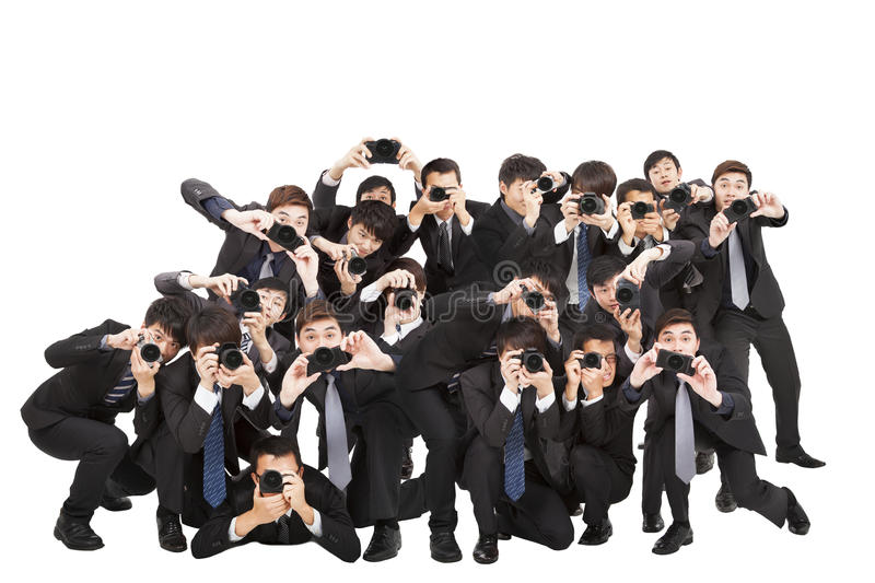 Photographers holding camera pointing to you stock photos