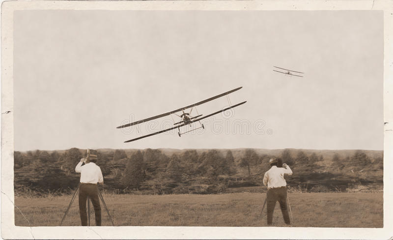 Photographers, old planes racing. Winner landing. royalty free stock images