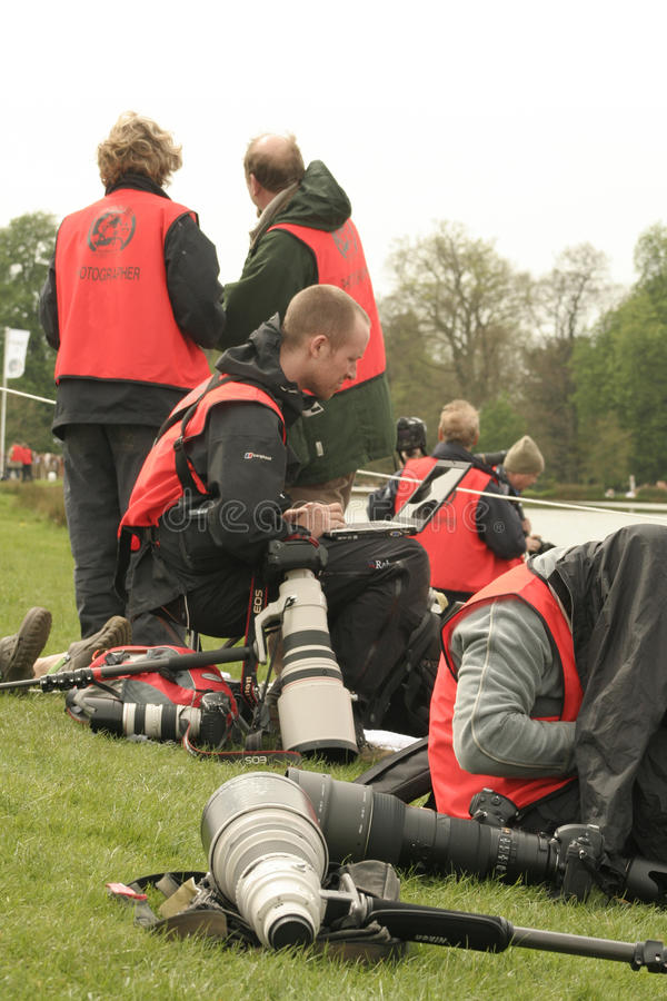 Photographers at a sporting event. A group of busy, working photographers at an outdoor sporting event, Mitsubishi Motors Badminton Horse Trials in May 2014 on royalty free stock photos