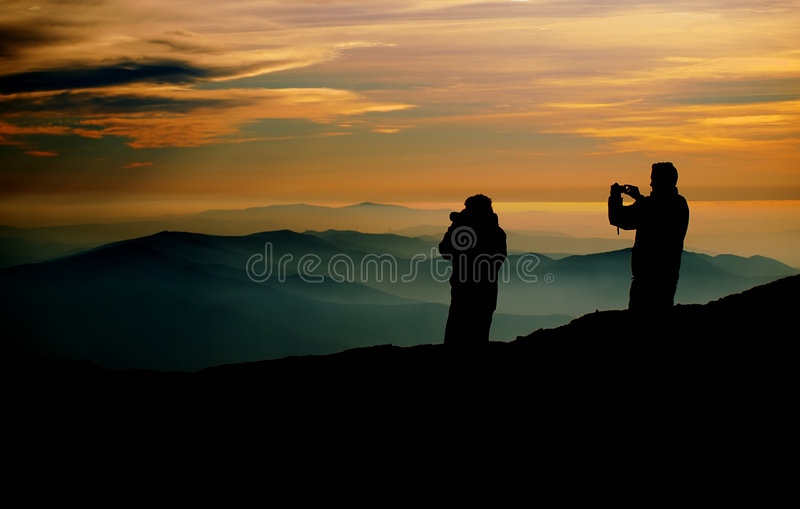 Photographers At Sunset Royalty Free Stock Images