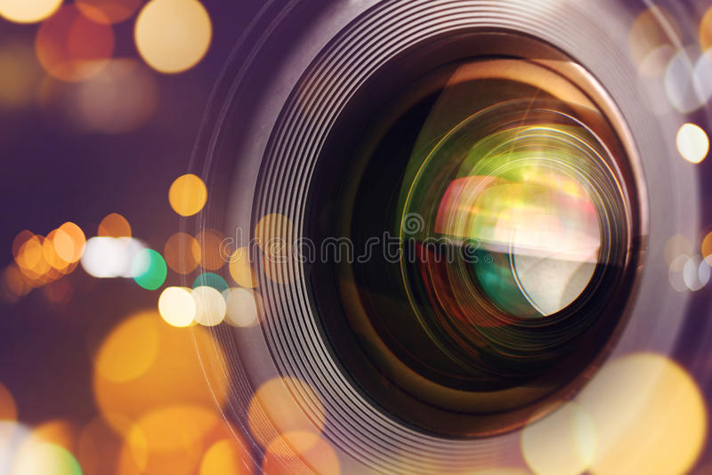 Photographic camera lens with bokeh light. Photographic camera lens front glass with bokeh light, macro shot stock photo