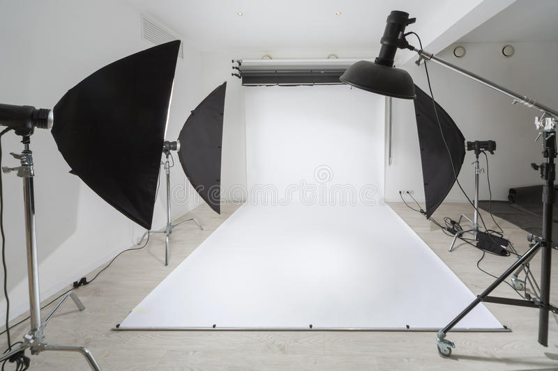 Photographic equipment. And a white backdrop in studio stock photo