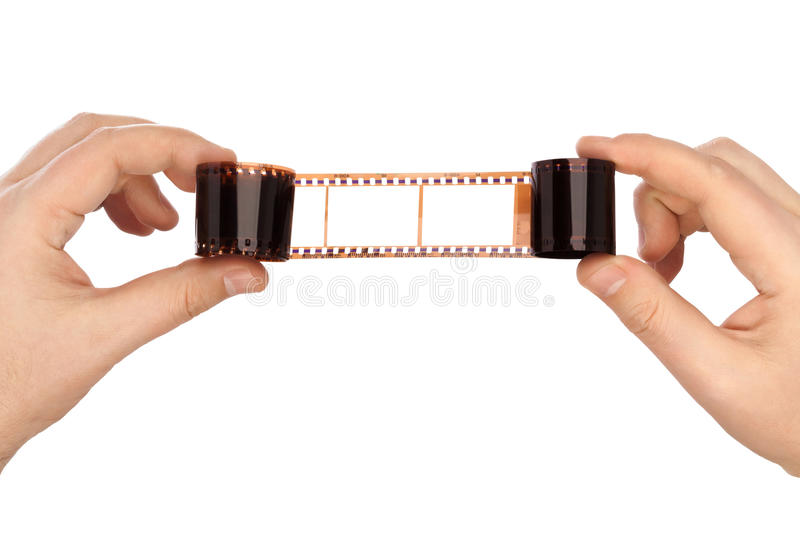 Photographic film in hands. Isolated on white background stock photography