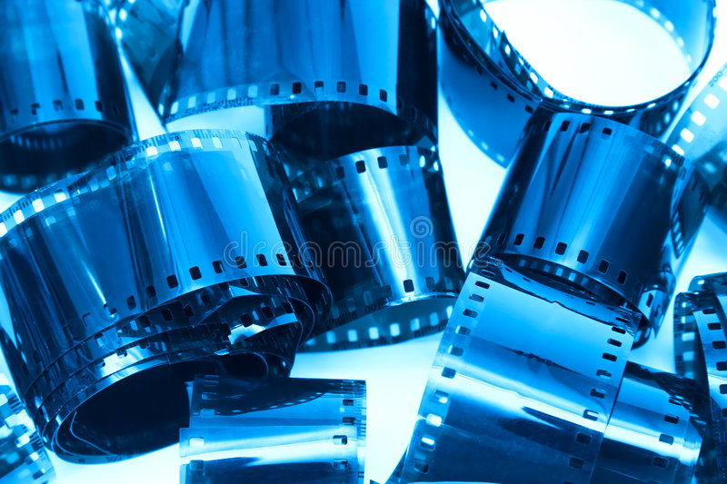 Photographic film pieces. Blue tint stock images
