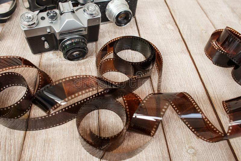 Photographic films. Lying on a table with two cameras stock photo