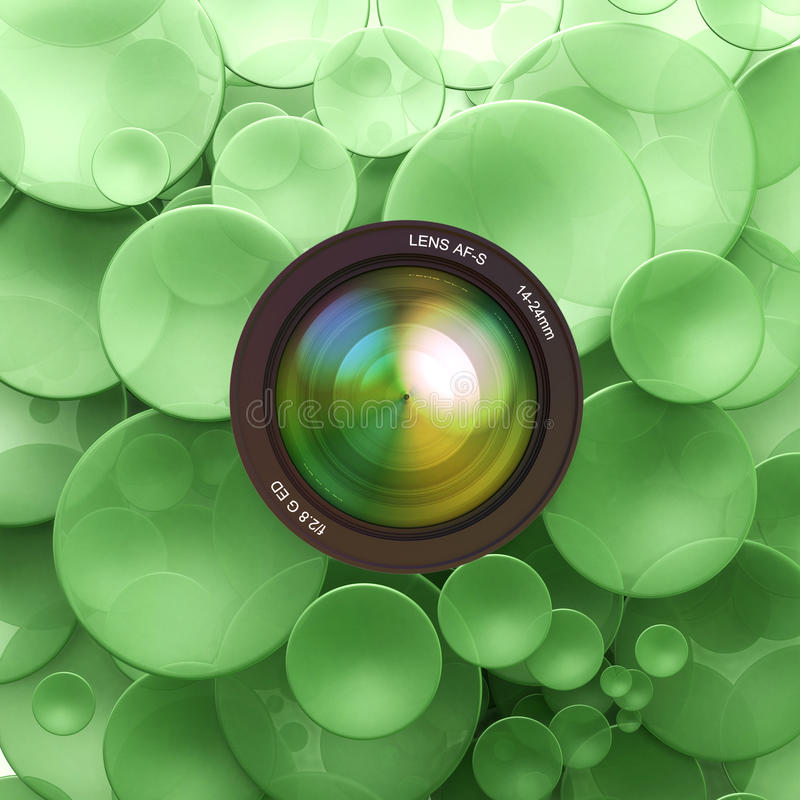 Photographic green background. Green disks and a camera lens royalty free illustration