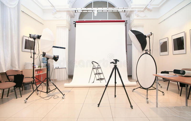 Photographic studio. With studio lighters and the equipment royalty free stock photography