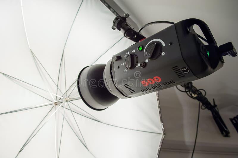 Photographic studio strobe lighting and reflective umbrella stock photos