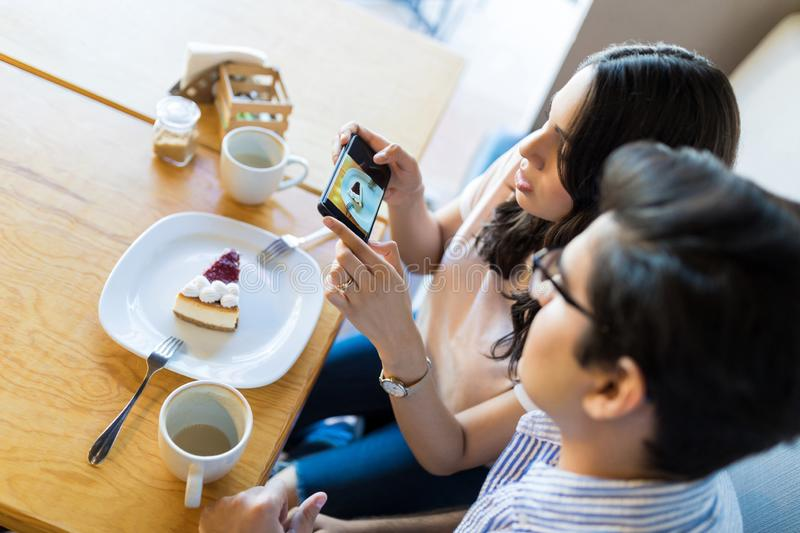 Photographing Food To Post Online In Coffee Shop stock image