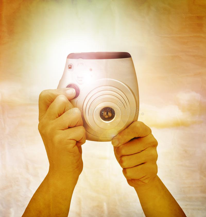 Snapshot with flash.  Vintage effect on Instant camera royalty free stock images