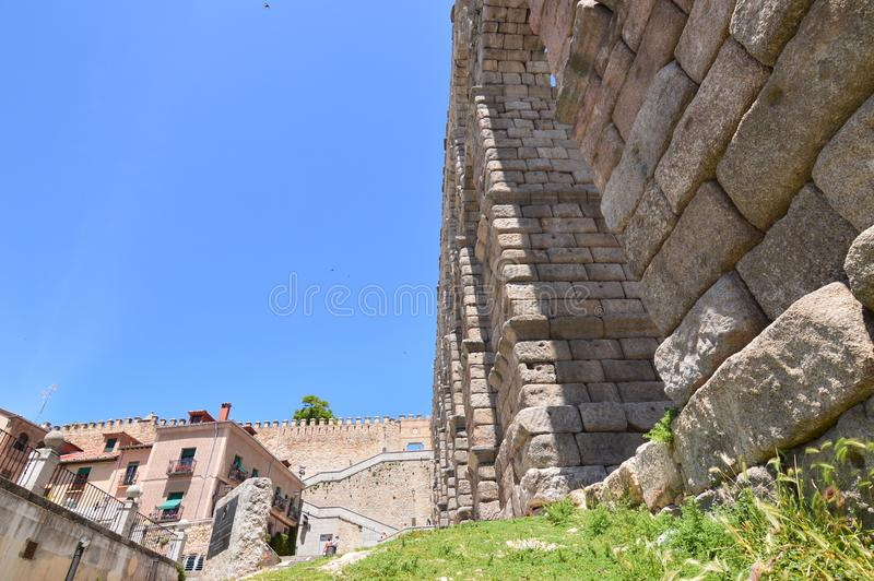 Photographs From The Base Of The Aqueduct To Be Able To Intuit Its Greatness In Segovia. stock images