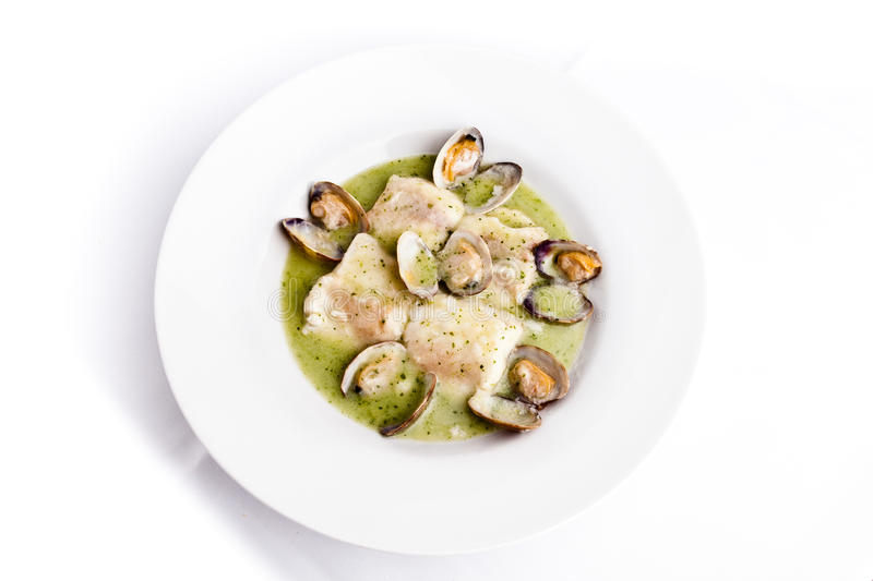 Hake with clams soup stock photo