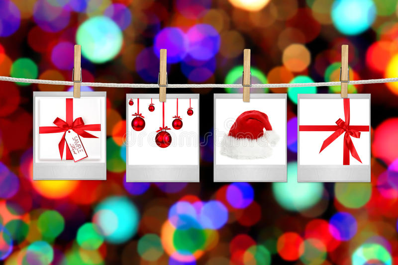 Photographs With Images of Christmas Themed Items. Film Blanks With Images of Christmas Themed Items Hanging on a Rope By Clothespins royalty free stock photos