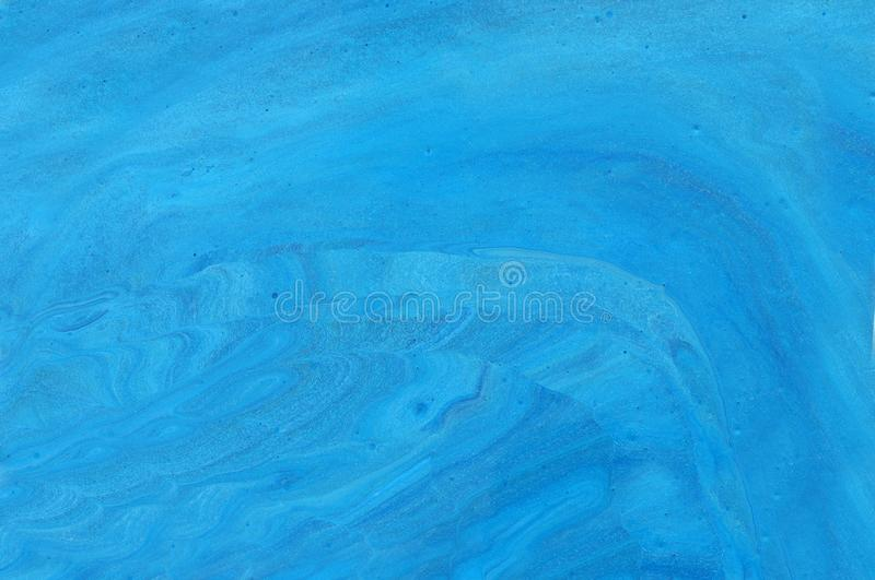 Photography of abstract marbleized effect background. Blue colors. Beautiful paint.  stock images
