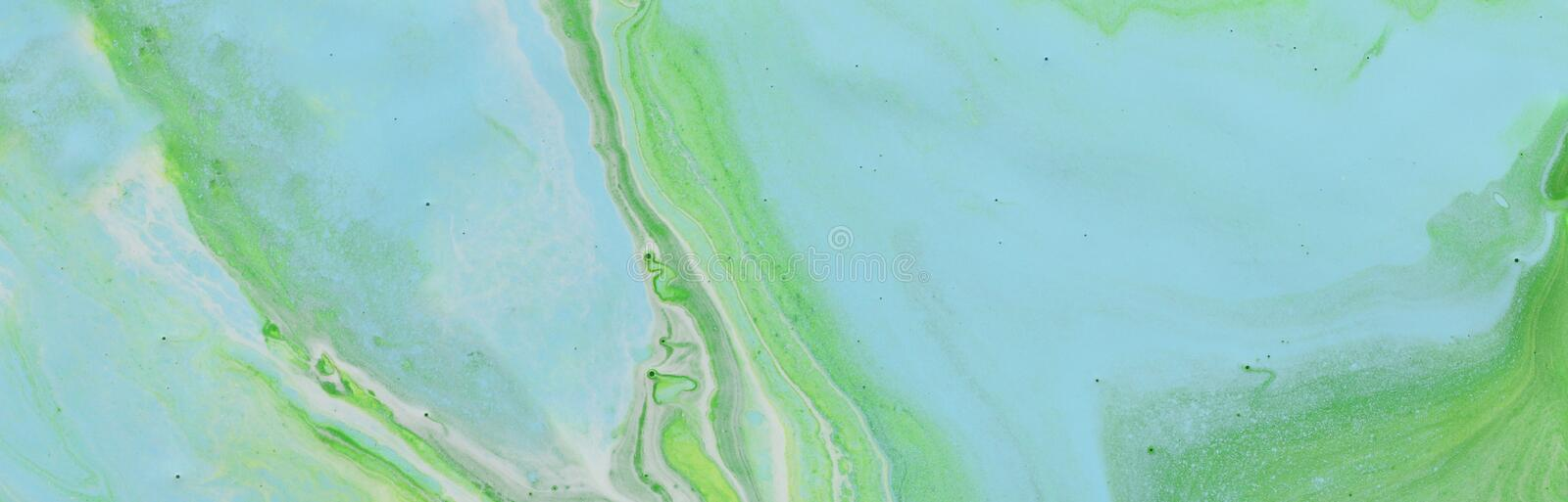 Photography of abstract marbleized effect background. blue and green creative colors. Beautiful paint. banner.  royalty free stock photo