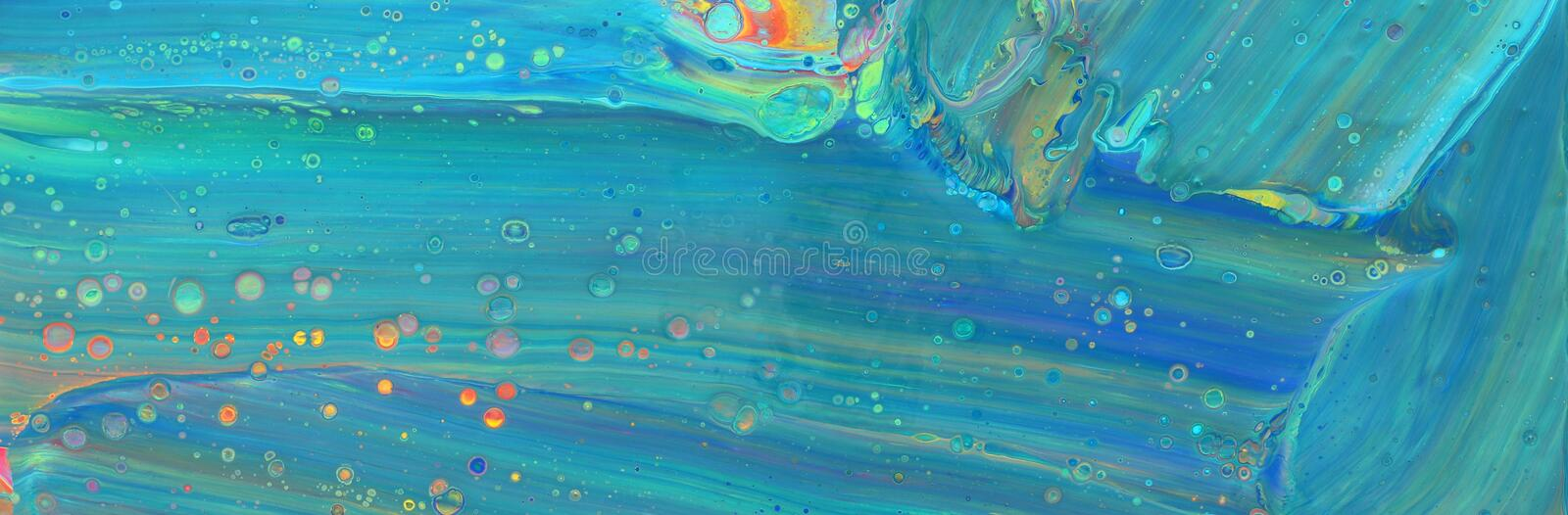 Photography of abstract marbleized effect background. Blue, mint and gold creative colors. Beautiful paint. banner.  royalty free stock images