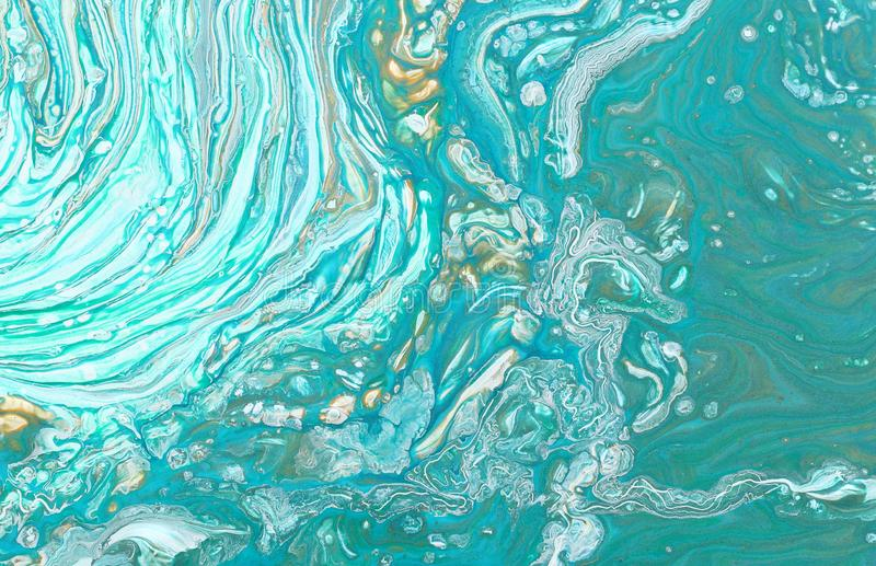 Photography of abstract marbleized effect background. Blue, mint, gold and white creative colors. Beautiful paint.  royalty free stock images