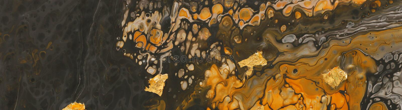 Photography of abstract marbleized effect background. yellow and black creative colors. Beautiful paint with the addition of gold. Banner royalty free stock photos