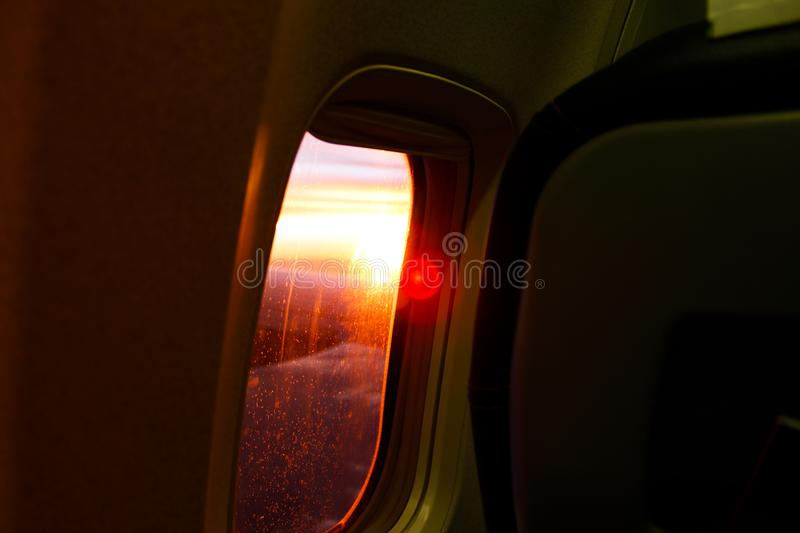 Photography of Airplane Window During Dusk royalty free stock photo
