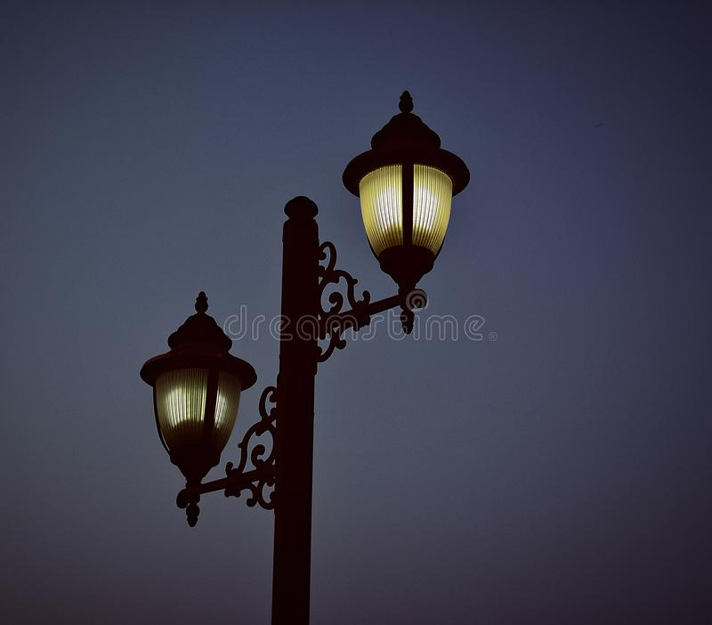 Photography of Black Metal Post Lamp During Night Time royalty free stock photos